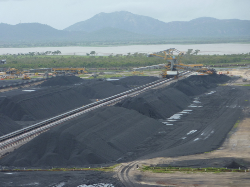 Coal stockyards at Abbot Point, with Caley Valley Wetlands in background